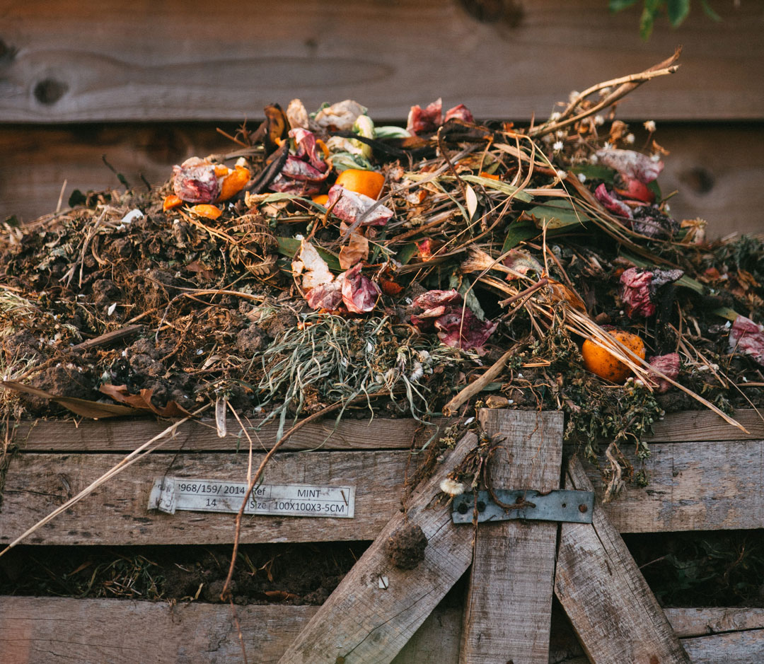 Compost piled on top of wooden bin
